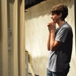 Senior Billy Fox prepares backstage for his scene as the character Tristan. Photo by Ava Simonsen