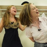 "Seniors Claire Evans and Gwen Madden sing ""If we were a movie"" from Hannah Montana in the dressing room getting ready for the second act.  Photo by Ava Simonsen"