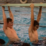 JV swimmers Michael Spivak and Lake Hylton hang on the board during warm ups. Photo by Kathleen Deedy