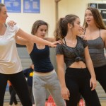Freshmen Lucy and Zoe Hartman and Hope and Hanna Robinette work on a move for their dance. Photo by Kathleen Deedy