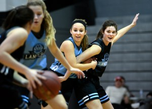 Juniors Emma Eberhart work to defend senior Caroline Blubaugh from a pass by junior Taylor Fort. Photo by Ellie Thoma