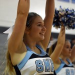 Sophomore Gabby Leinbach cheers on the sidelines of the first home basketball game against Bishop Seabury. Photo by Katherine Odell
