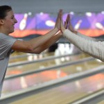 Seniors Anna Kanaley and Kirby Motsinger high five after a successful game. Photo by Luke Hoffman