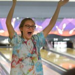 Junior Audrey Helmuth is excited after she throws a strike. Photo by Luke Hoffman