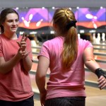 Junior Olivia Perry assists another bowler with her shot. Photo by Luke Hoffman