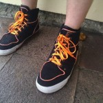 Crazy black sneaks with orange laces in Santa Monica