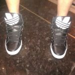 Black Adidas high tops at Cosmopolitan Hotel in elevator - Vegas