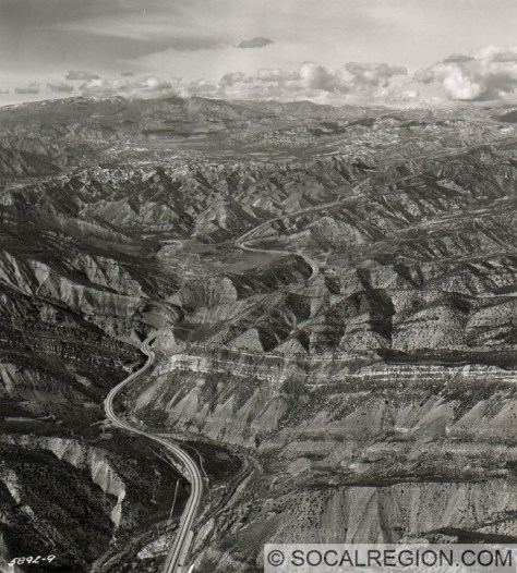 1958 view looking northerly from above Piru Gorge. Pyramid Rock is at center. Courtesy - Caltrans.