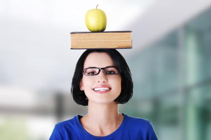 Woman holding an apple on head