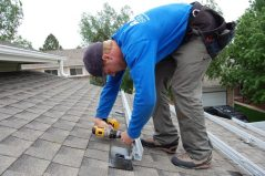 Tim installs grounding hardware onto the rails at 9:45 a.m. on Day 2.