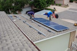 Four panels and counting on the lower garage roof area -- we're getting there!