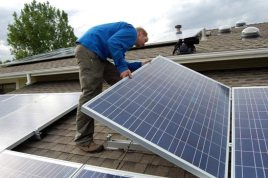 Tim sets the final panel of our 5.59 kW solar system at 5:55 p.m. on Day 2.
