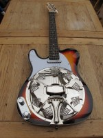 """Another left handed Sollophonic, this time in sunburst with a white Hotrail pickup in a white scratchplate. New owner says """"Must let you know how happy I am. The tone is great, and it is so """"player friendly"""". I'm very impressed, and you have most happy customer."""""""