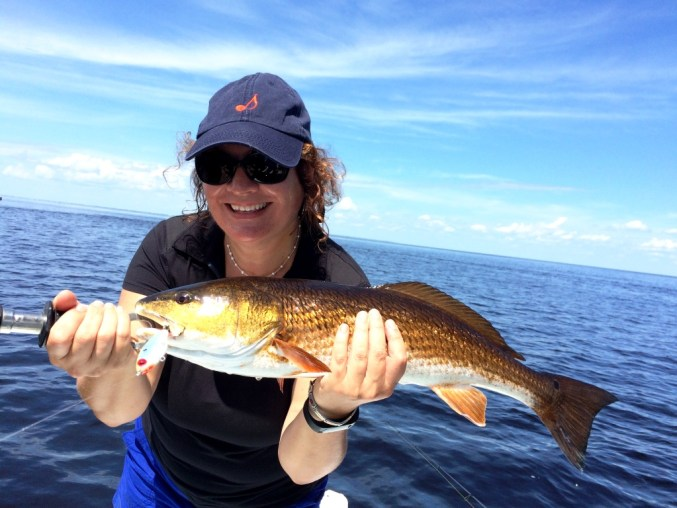 Me with a Redfish on Charlotte Harbor, Fla. Caught with a MirrOlure MirrOdine XL 27MR Suspending Jerk Bait
