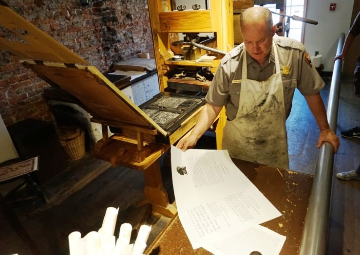 A National Park Service Ranger Gives a Printing Demonstration at the Franklin Court Printing Office in Philadelphia.