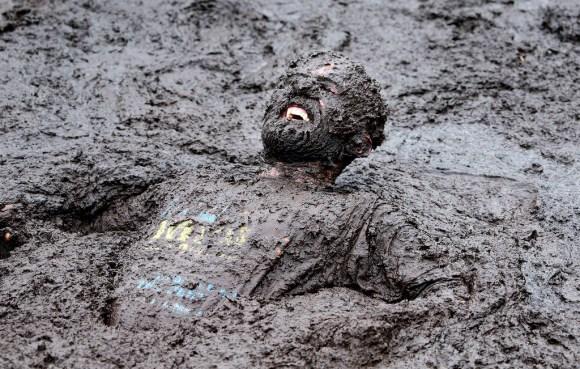 """""""TOPSHOTS 2014-BRITAIN-OFFBEAT-MUD RACE"""""""