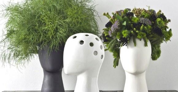 As plantas são os cabelos desses vasos em formato de cabeça