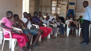 The National SCREAM trainer facilitating a sesion during Hold While you wait sessions for Busia