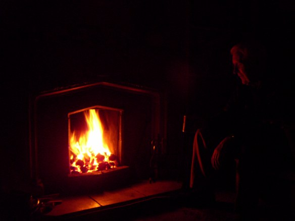 Dad sitting by his fire. December 2009