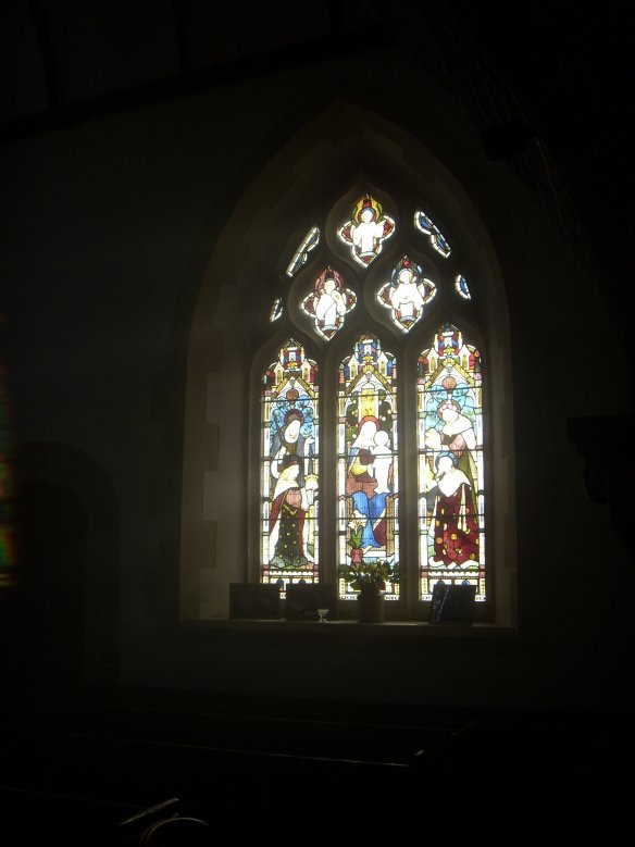 Photographs of Dad on the sill of 'The Epiphany Window - The Adoration of the Magi'