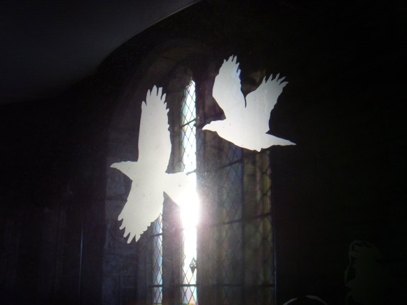 A pair of Ravens etched in a glass screen in Walkhampton Church - Dartmoor.