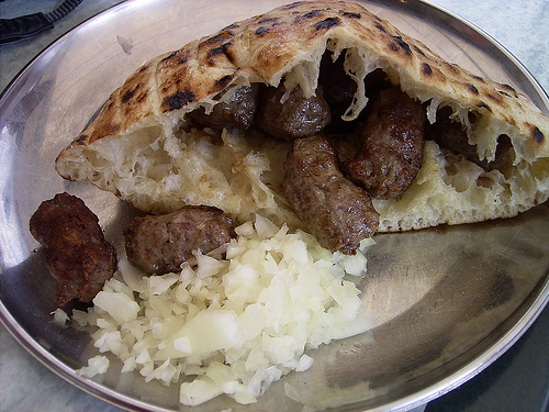 Cevapi - Sarajevo specialty beef kebabs, bread and onion