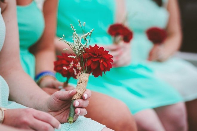 Turquoise bridesmaid dresses and red flowers