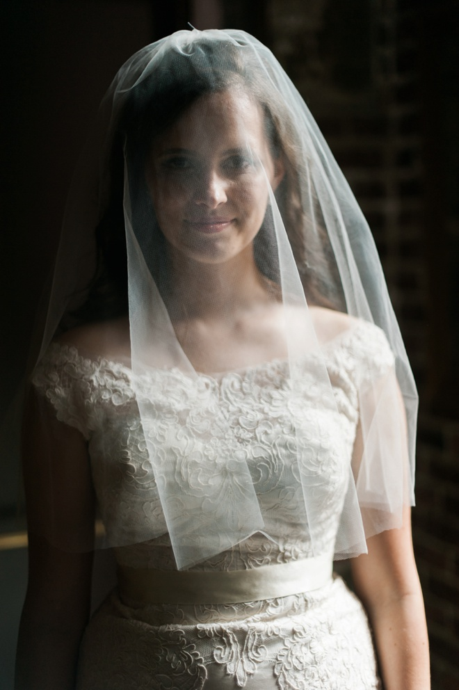 Bride looking stunning with her blusher veil.