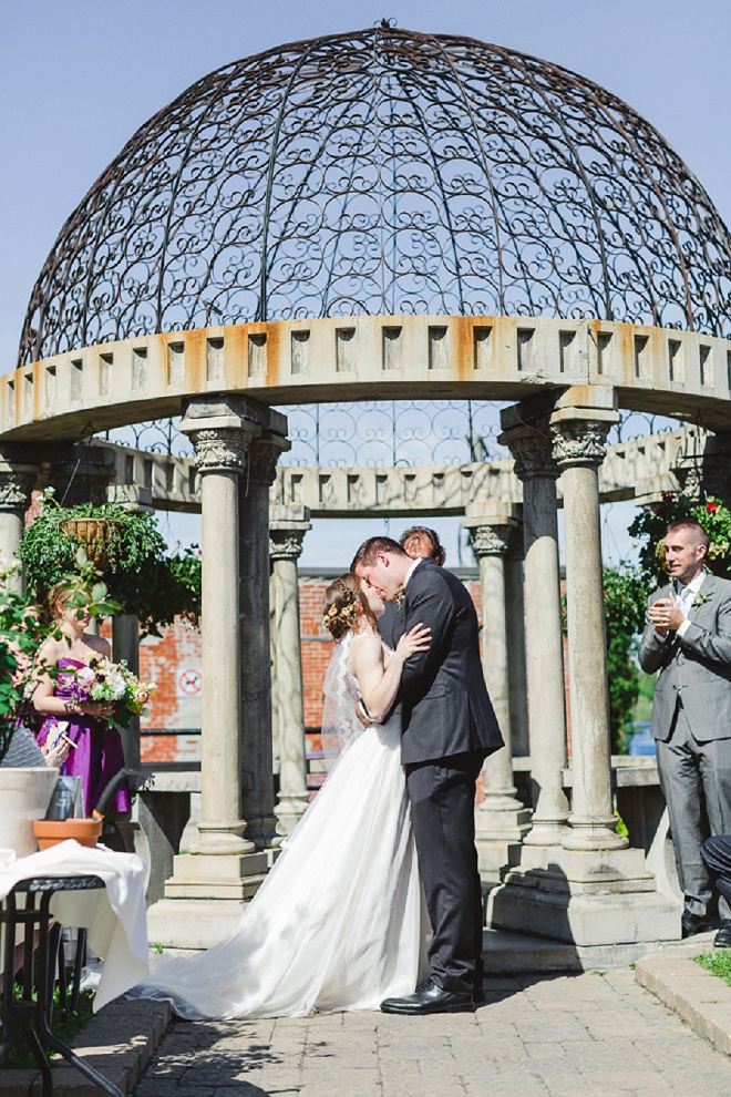 Darling first kiss at this beautiful outdoor ceremony!
