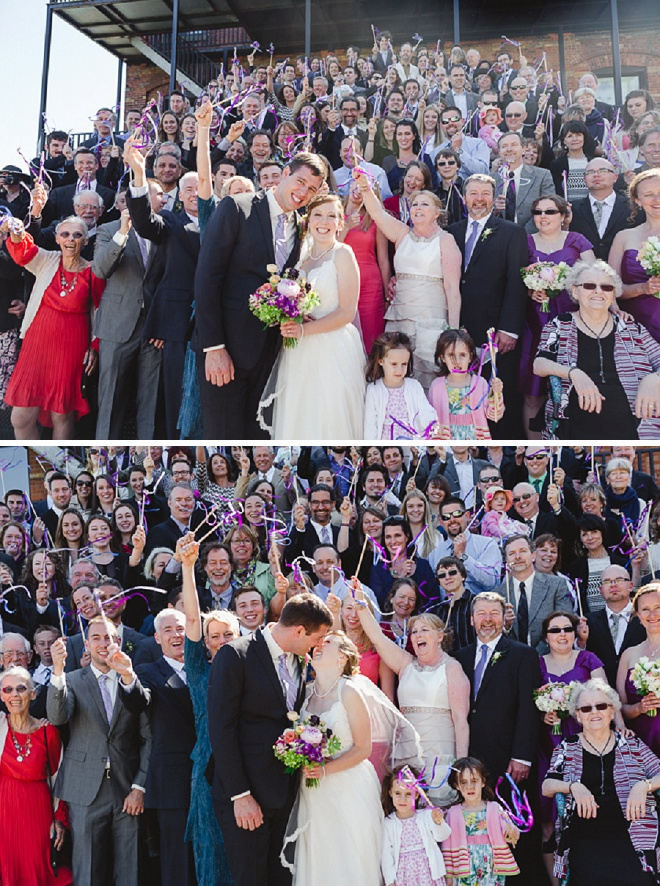 How FUN is this wedding photo with all of their guests?! Love it!