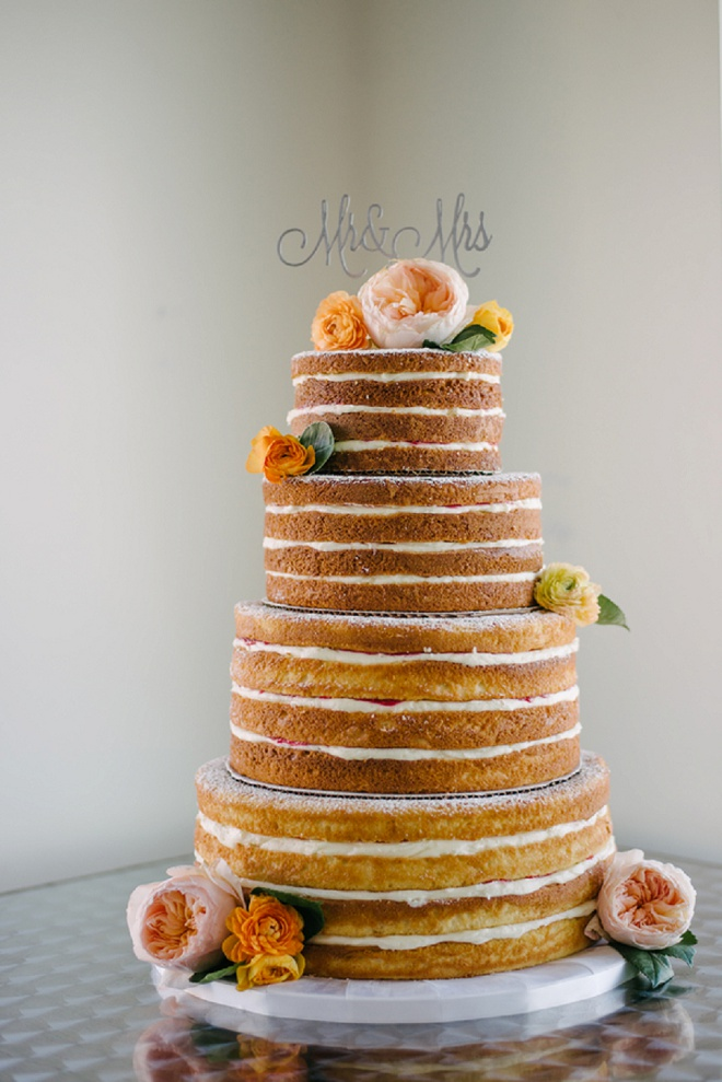 How gorgeous is this naked cake with Mr and Mrs cake topper?! Swoon!
