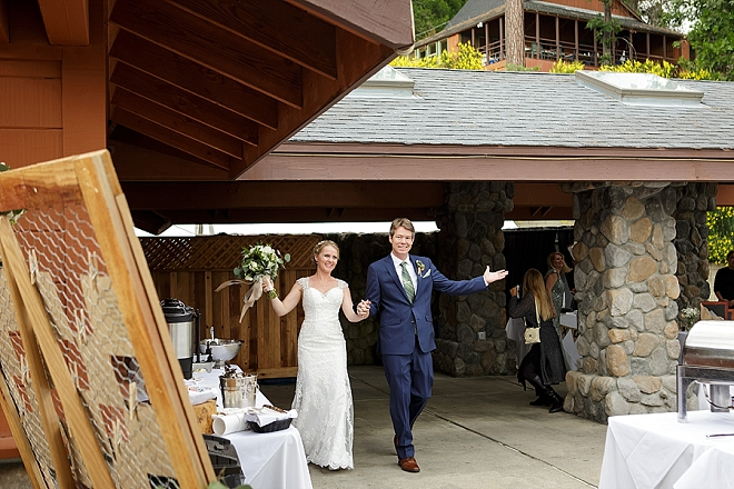 Entering their reception as Mr. and Mrs!