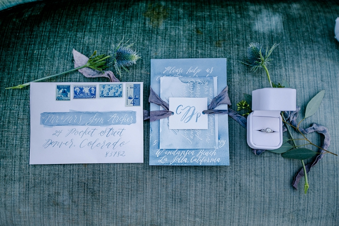 How stunning are these invitations at this styled moody mermaid beach wedding?! LOVE!