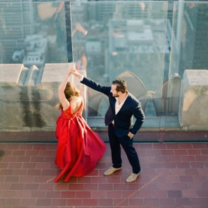 Try dancing on top of the world for your engagement photos.