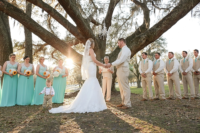 We're swooning over this stunning outdoor ceremony and gorgeous aisle decor!