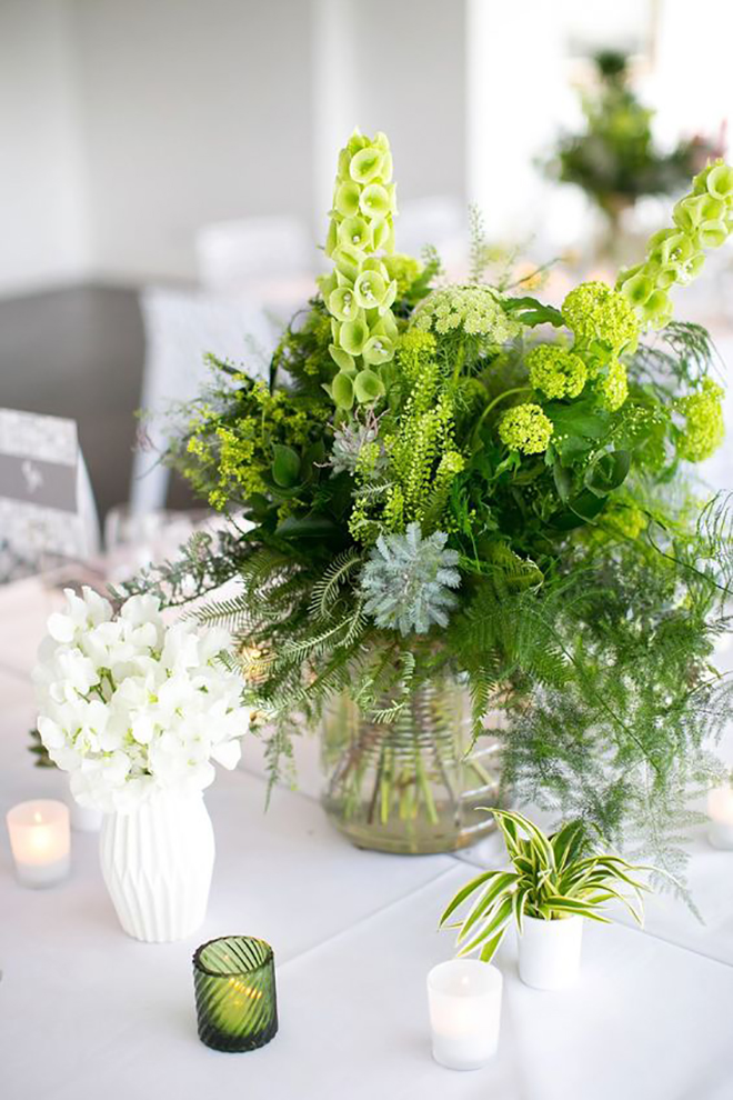Layer greenery colors to make a statement centerpiece.