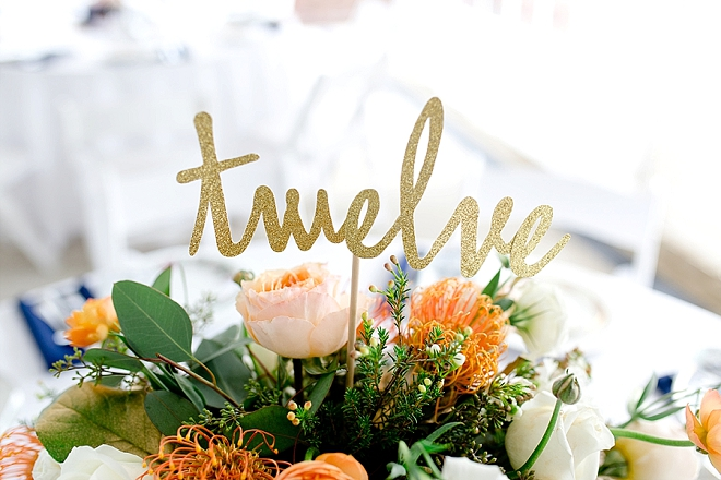 We are obsessed with these amazing floral and gold glittery centerpieces!