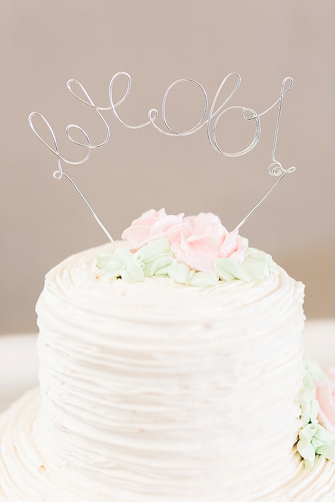Loving this super sweet wedding cut cake and metal We Do cake topper!