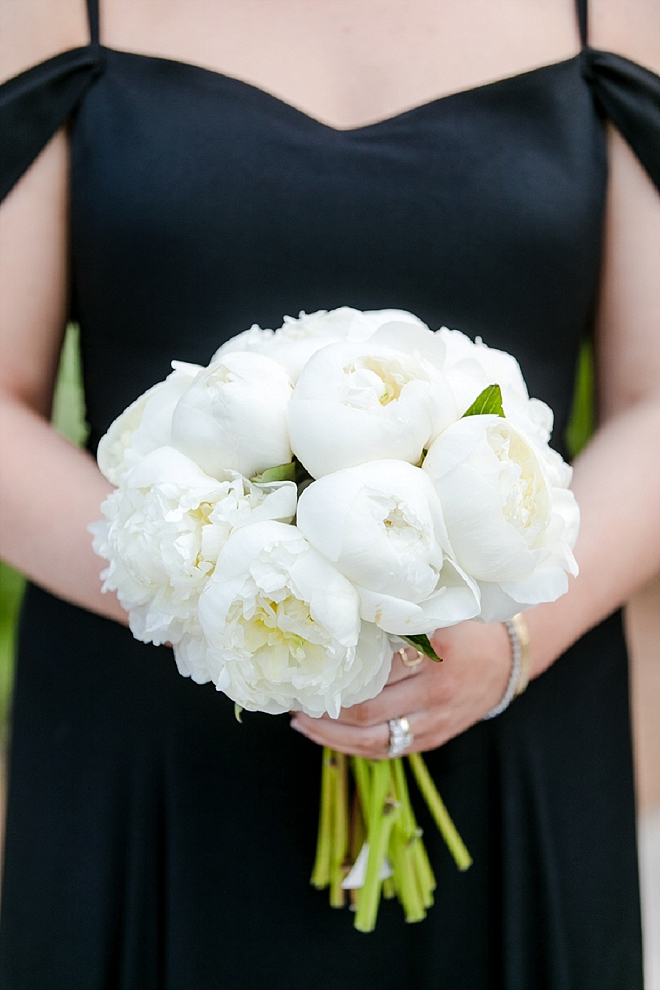 Loving these classic black bridesmaid's dresses with all white bouquets!