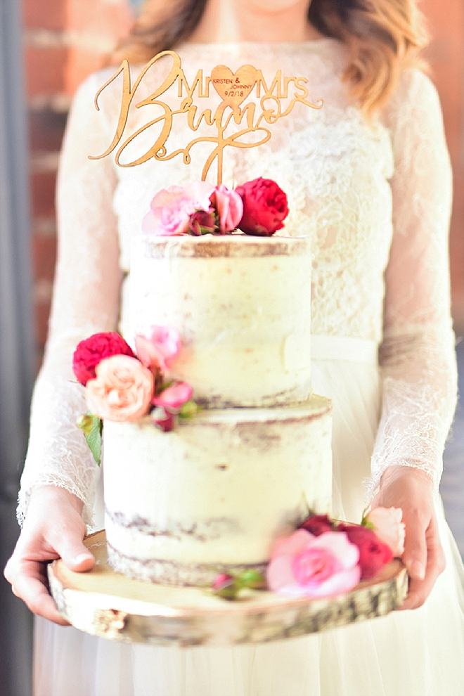Swooning over this gorgeous naked wedding cake with customized wooden cake topper!