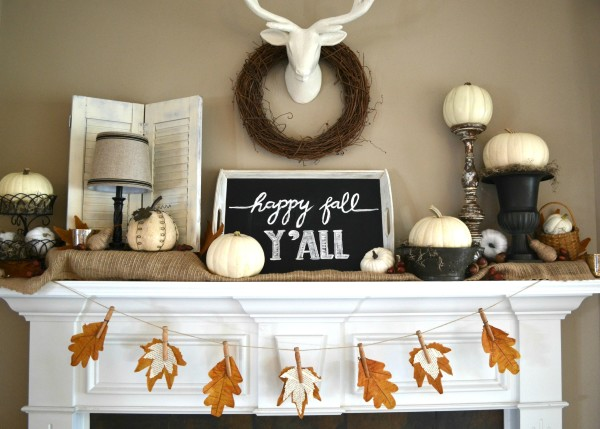 Fall leaf banner on the mantle with book page leaves