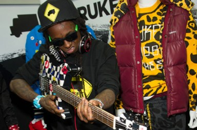 Business mogul and performing artist, Lil Wayne, at the Trukfit booth