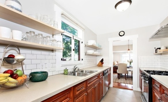 Sweet petite craftsman abode in highland park soulful for Updated galley kitchen photos
