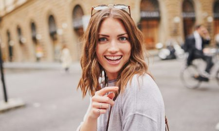 woman-smiling-pointing-street (1)