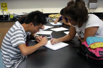 Juniors Skyler Pang and Vivian Rivera share their PBL ideas during their Physics class on the first day of school. Photo Credit: Bree Eure