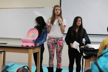Pulling questions out of a potty-training toilet, sophomore medical students Allison Lan, Tara Eskic and Kathleen Jaictin ask questions from their game involving urinary tract diseases. Hailey Basner