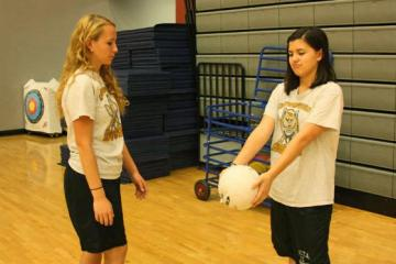 """Sophomores Savannah Rush and Katherina Pacheco did not have access to the net after the meeting was cancelled. They instead found an open area and practiced passing the ball to each other. """"It was disappointing that Volleyball Club didn't have the nets but it was still fun to play volleyball with my friend,"""" Rush said.  Photo Credit: Jorge Carrera"""