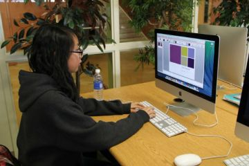 "Freshman Francesca Ngo discovers different features of PowerPoint. This application along with others were made available to students on Jan. 1. ""Microsoft helps a lot with my schoolwork. I use it on a regular basis,"" Ngo said.  Photo Credit: Jenika Chiang"