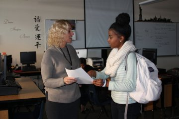 """Fitness Club adviser Ms. Linda Burns explains the requirements for joining the club to senior Amelinda Futsum. At the beginning of the year, the club was cancelled due to the lack of an adviser, but will have the first meeting of the school year on Jan. 23. """"Yoga will be the most interesting part for me. I've never done it before, but it seems like an activity that I would like,"""" Futsum said. Photo Credit: Helen Abraha"""