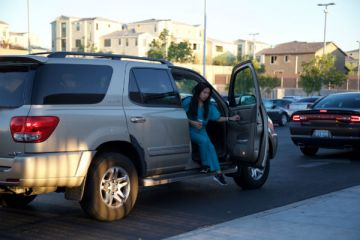 Senior Jessa Bermudez exits her car in the student drop-off area on Sept. 24. From 6 a.m. to 6:55 a.m. on Sept. 22, 12 u-turns were made in the student drop-off area.  Photo Credit: Jen Chiang